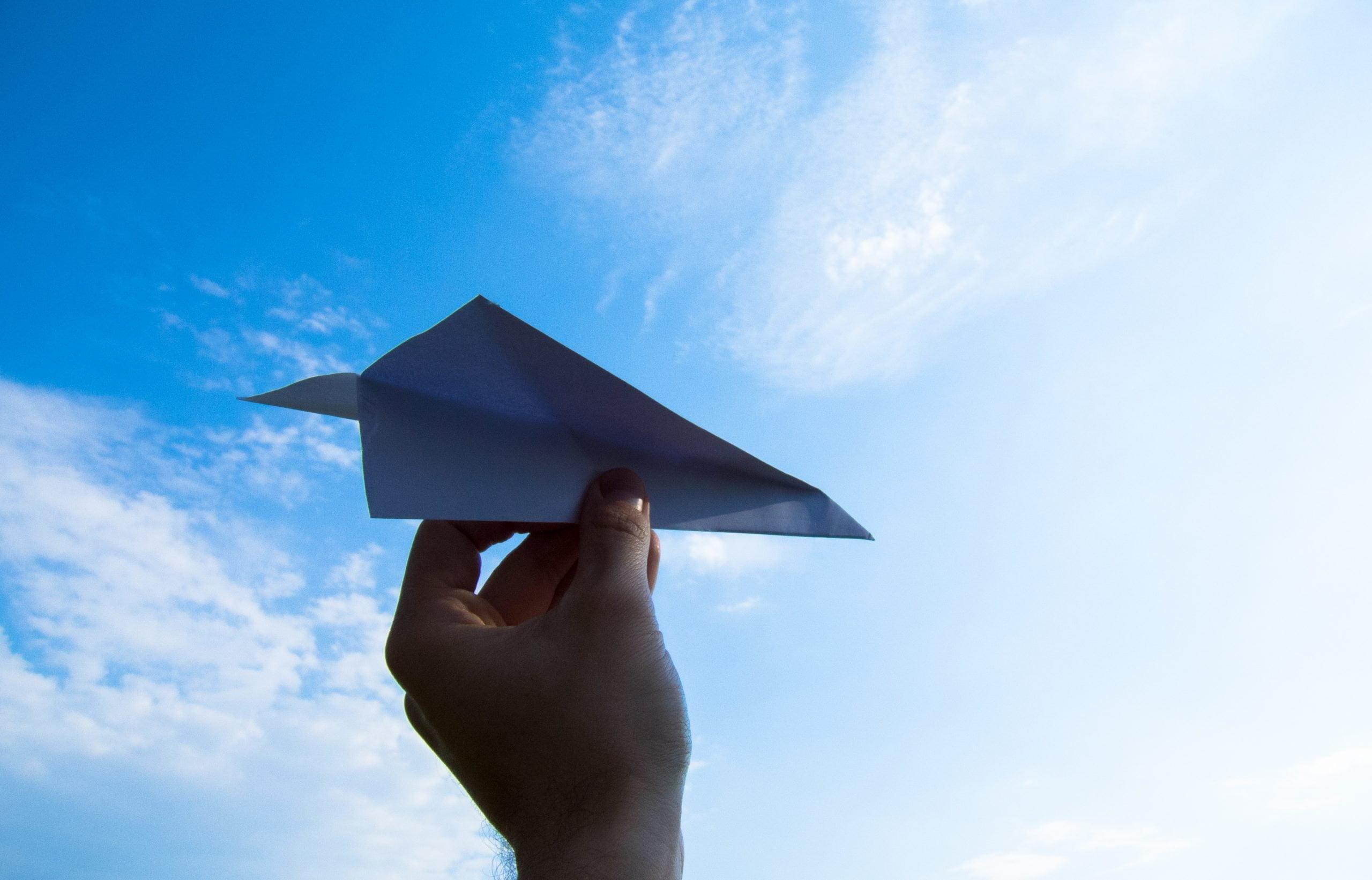 paper plane, the hand, sky